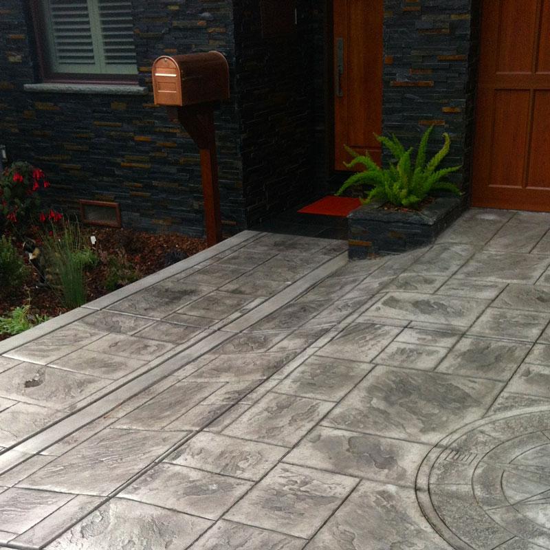549a21960718e0ad79f4cc11_Stamped-Concrete.jpg