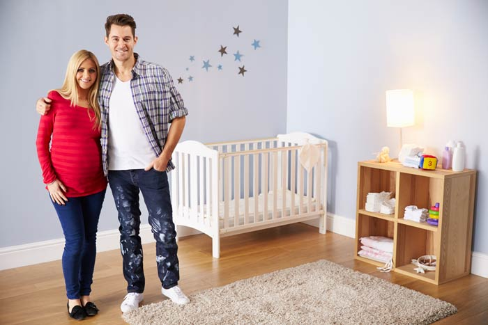 Couple In Their Child's Bedroom