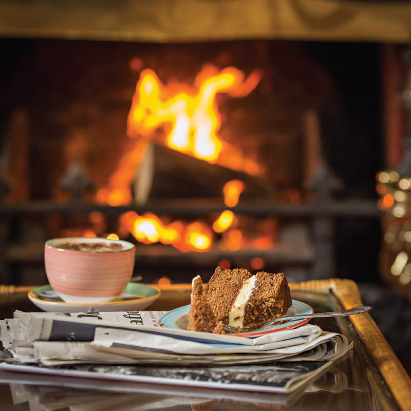 Coffee & cake infront of an open fire at the Cliftonville Hotel, Cromer, Norfolk
