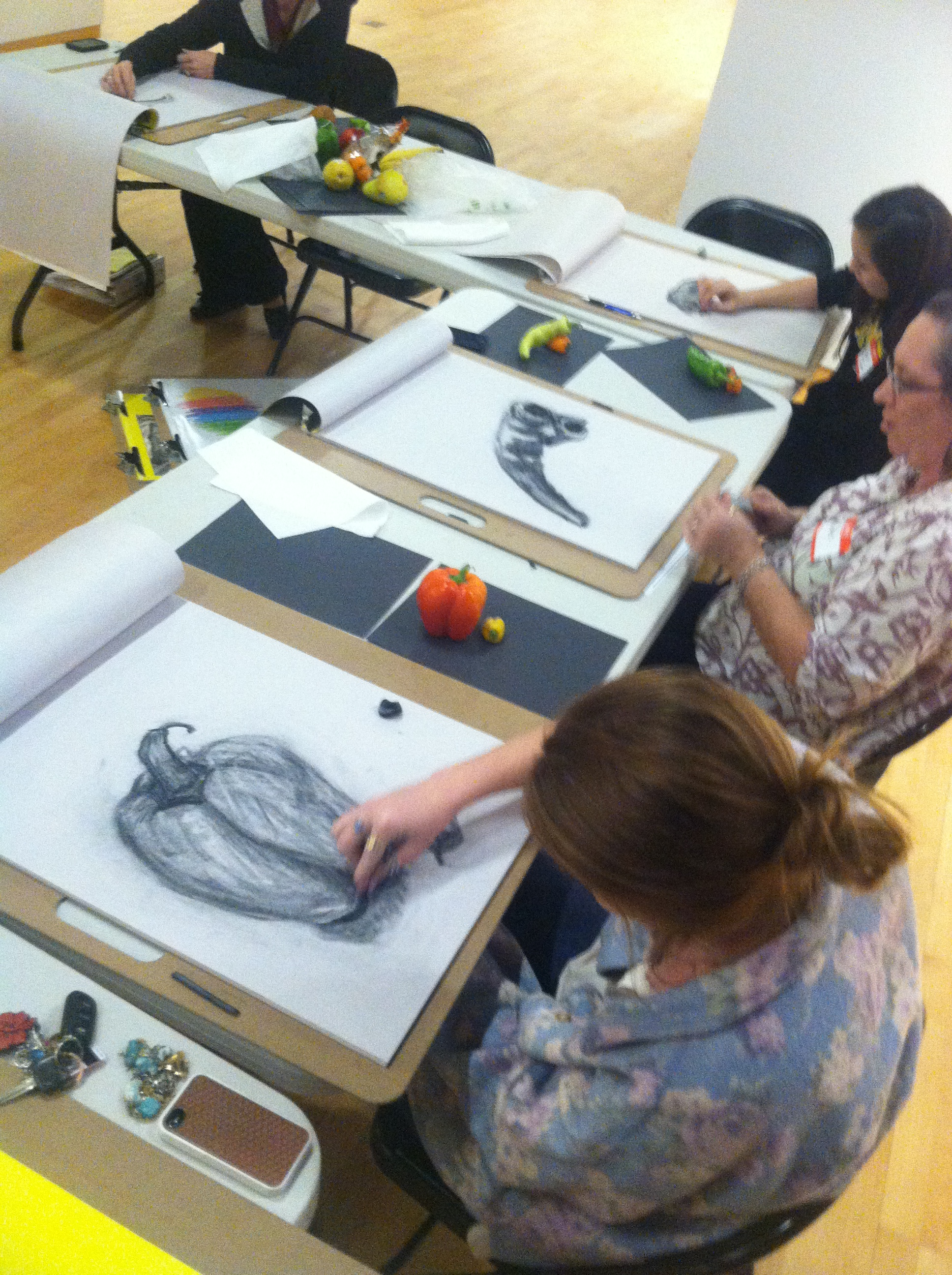 Students drawing various vegetables