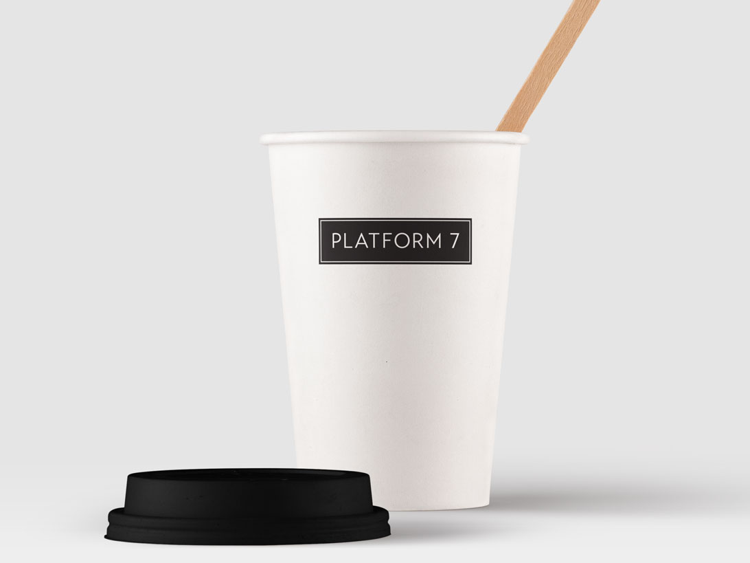 Platform 7 logo applied to a paper cup.