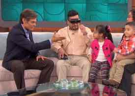 Photo of Warren and his family with Dr. Oz