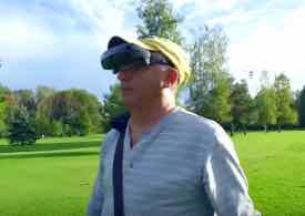 Photo of Mike wearing eSight on a golf course