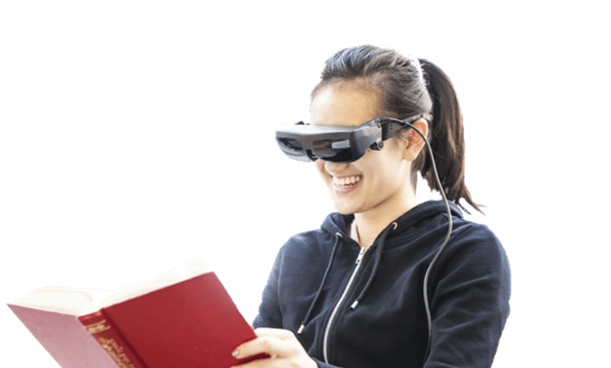 Woman wearing eSight and reading