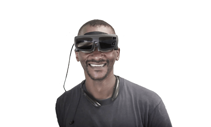 Man wearing eSight and smiling