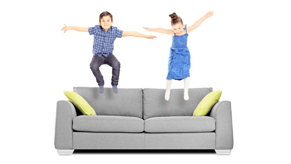 photo of kids jumping on sofa