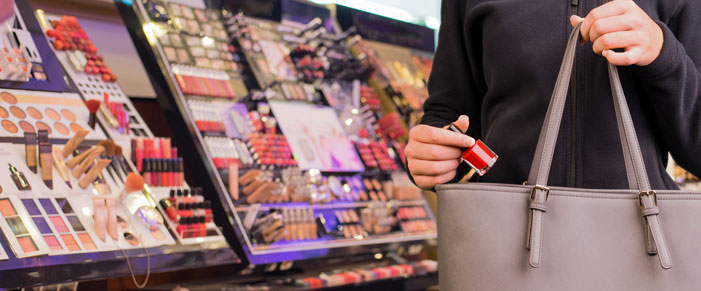Girl shoplifting makeup