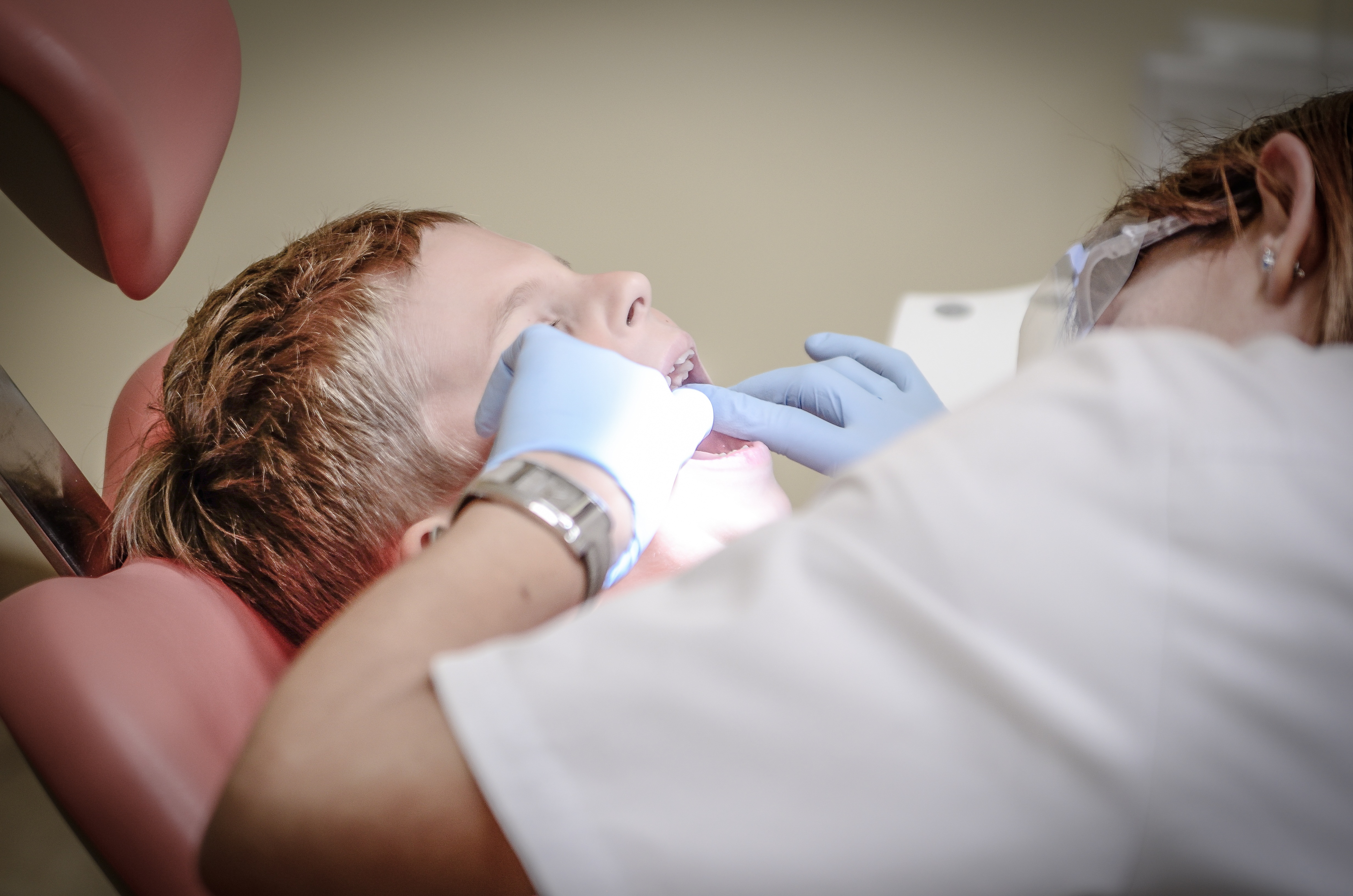 What is the difference between a dental crown and a filling?