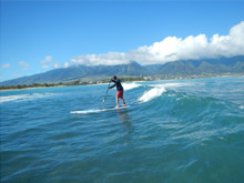 Surfing SUP race board off Kanaha