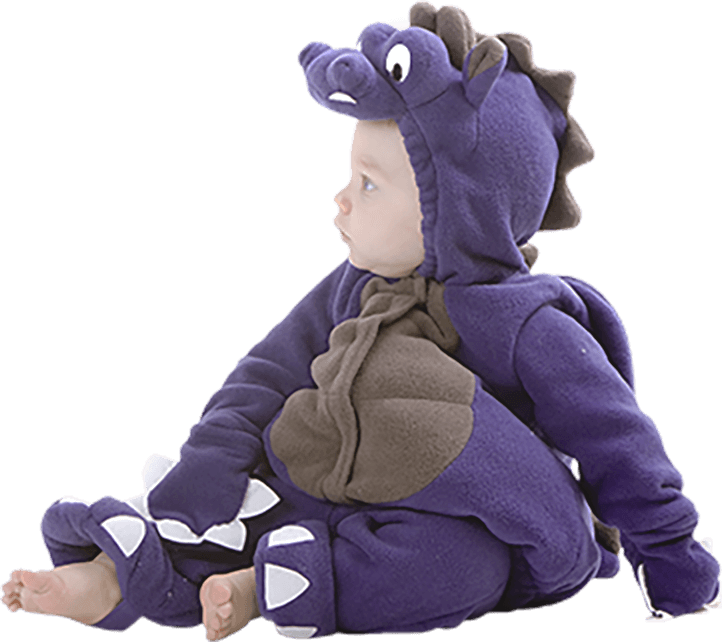 Caucasian toddler boy dressed in a purple dinosaur costume