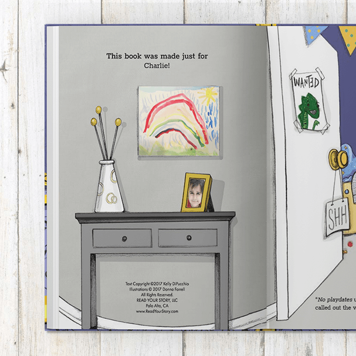 Copyright page showing an illustrated room with gray walls with a rainbow painting.  Console table with child's photo in a yellow picture frame as well as a vase of flowers
