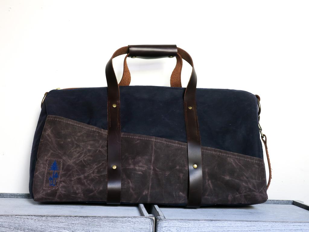 Uphill Designs - Cobalt waxed canvas duffel back - navy blue - front