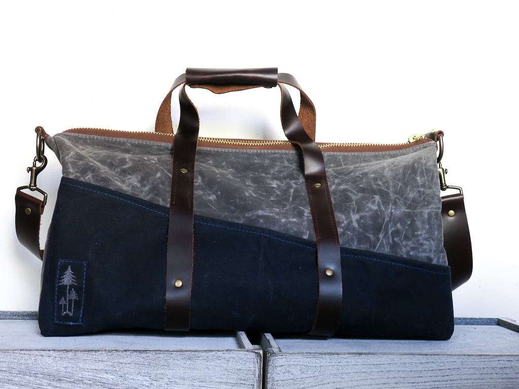 Uphill Designs - Cobalt waxed canvas duffel back - charcoal grey - front