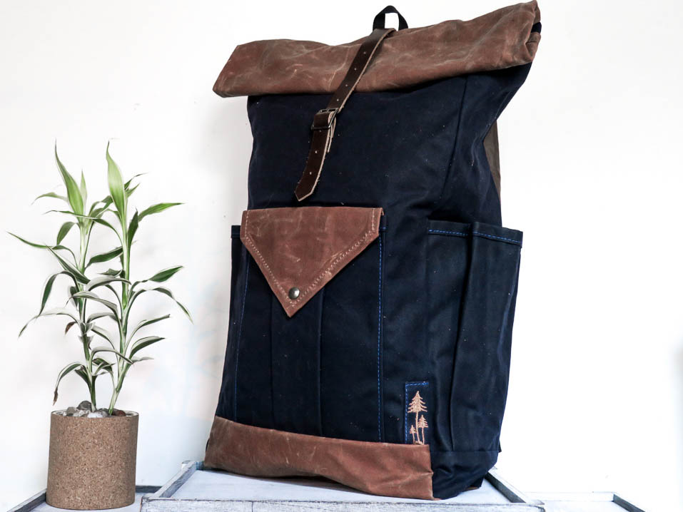 Uphill Designs - waxed canvas large Crest backpack - navy - angled