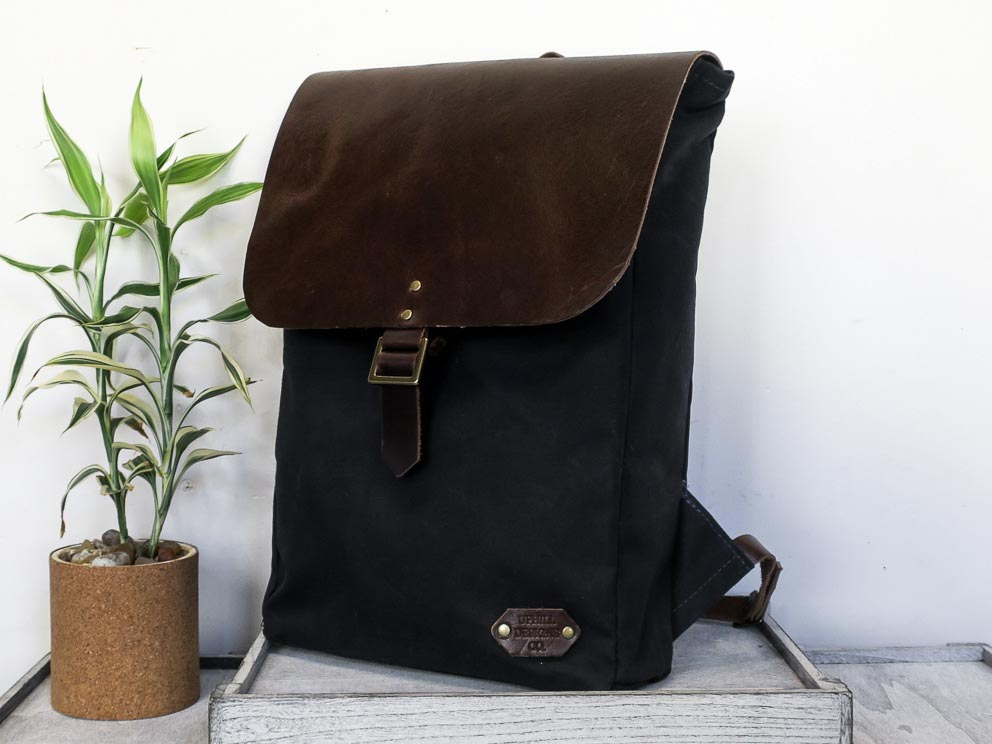 Uphill Designs - Potomac select waxed canvas and leather rucksack - navy blue and brown leather - angled front