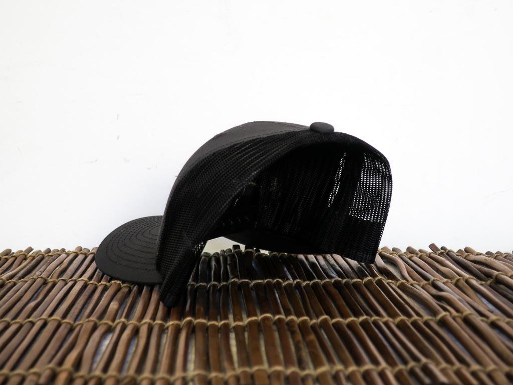 Uphill Designs - trucker hat - dark grey - green stitching - back