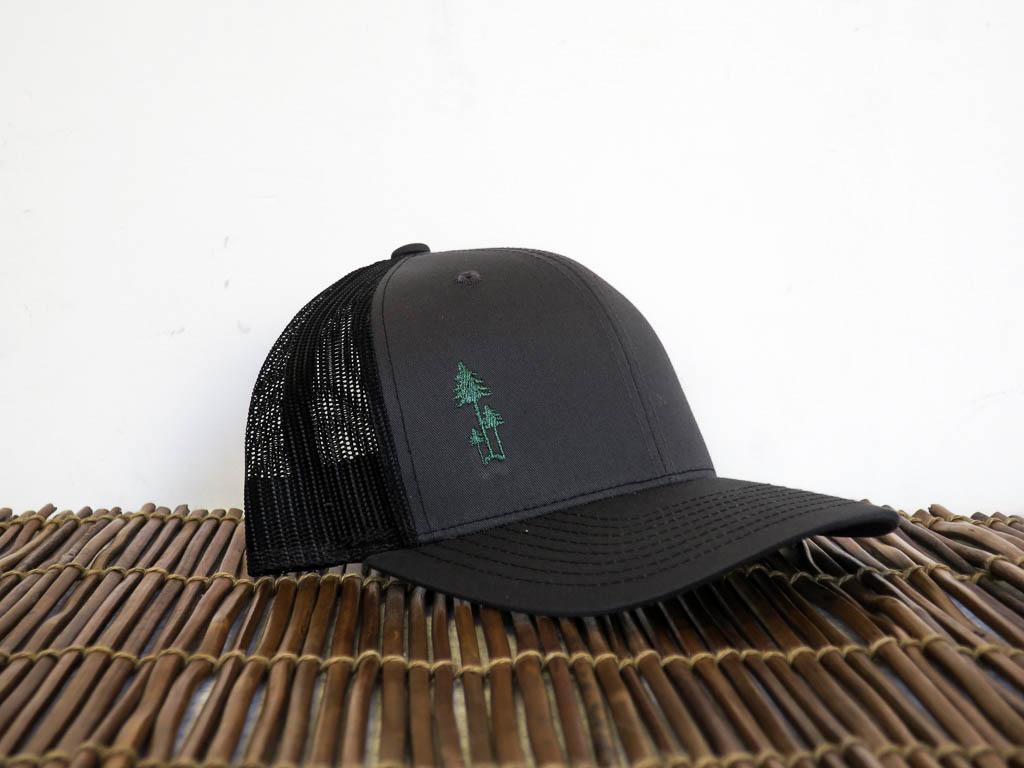 Uphill Designs - trucker hat - dark grey - green stitching - three trees logo