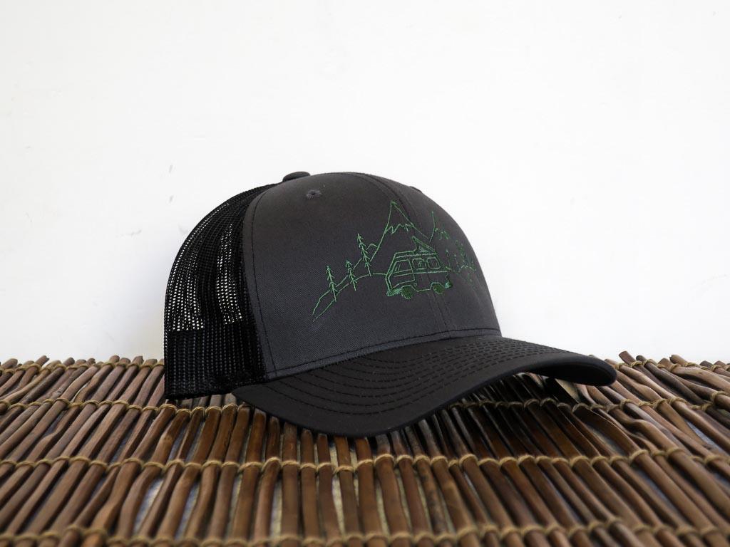 Uphill Designs - trucker hat - dark grey - green stitching - daydream design
