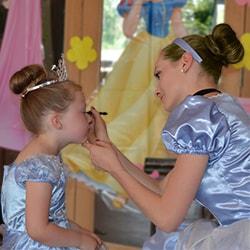 Cinderella Princess applying make-up to child
