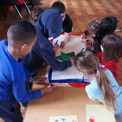 kids at a workshop colouring a flag