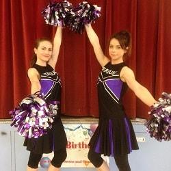 Two cheerleader entertainers posing