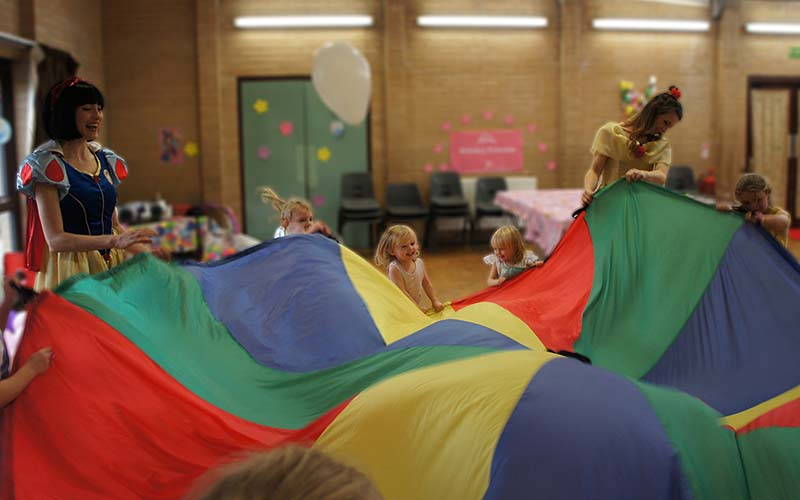 Snow white and belle playing parachute games