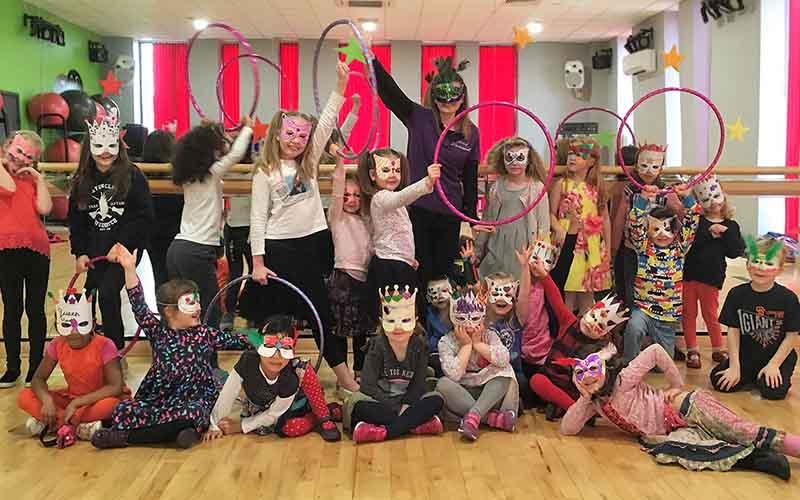 Kids posing with carnival workshop masks on