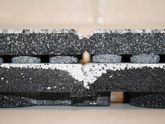 Seam comparison DuraTrain ( bottom) and regular rubber tiles Photo