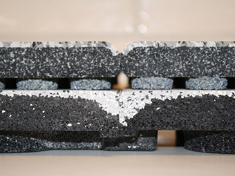 Seam comparison DuraTrain ( bottom) and regular rubber tiles Photo
