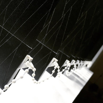 black patterned vertical blinds