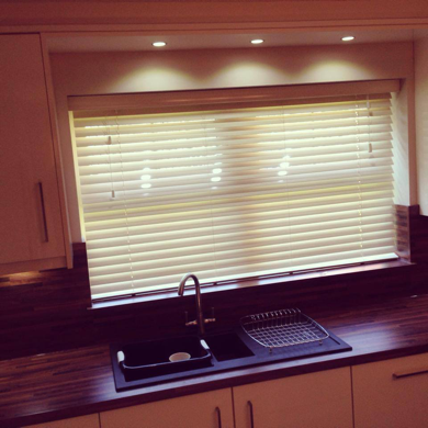 wooden venetian blind fitted in kitchen