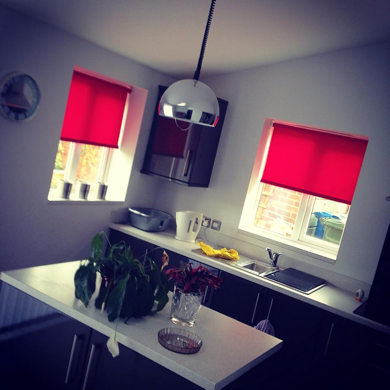 red roller blinds fitted in kitchen