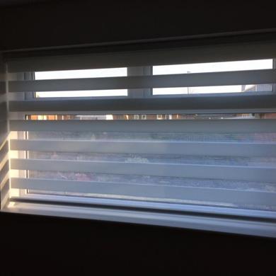 white vision blind in bedroom