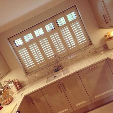cream plantation shutter in kitchen