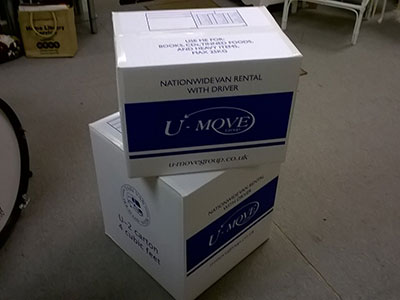 photo of u move boxes