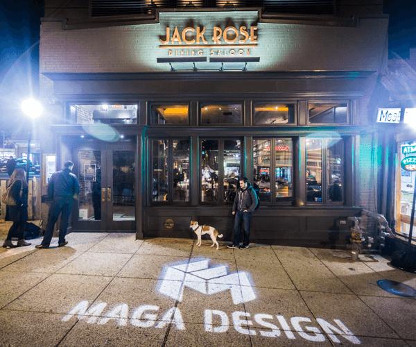 Maga Design logo projected on Adams Morgan sidewalk