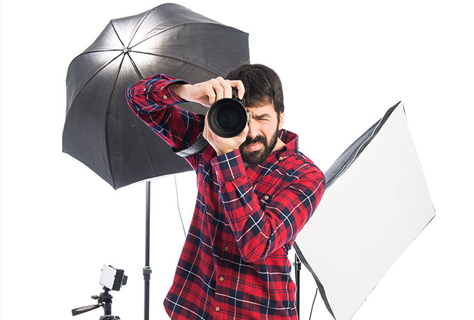 studio photographer takes a picture