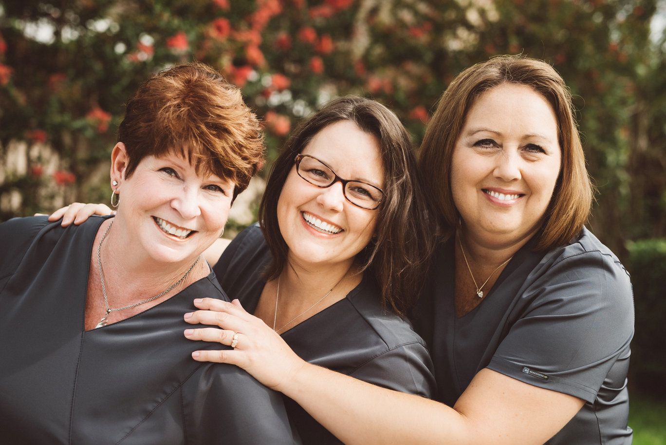 Photo of Bev, Christy, and Theresa, our dental hygienists.