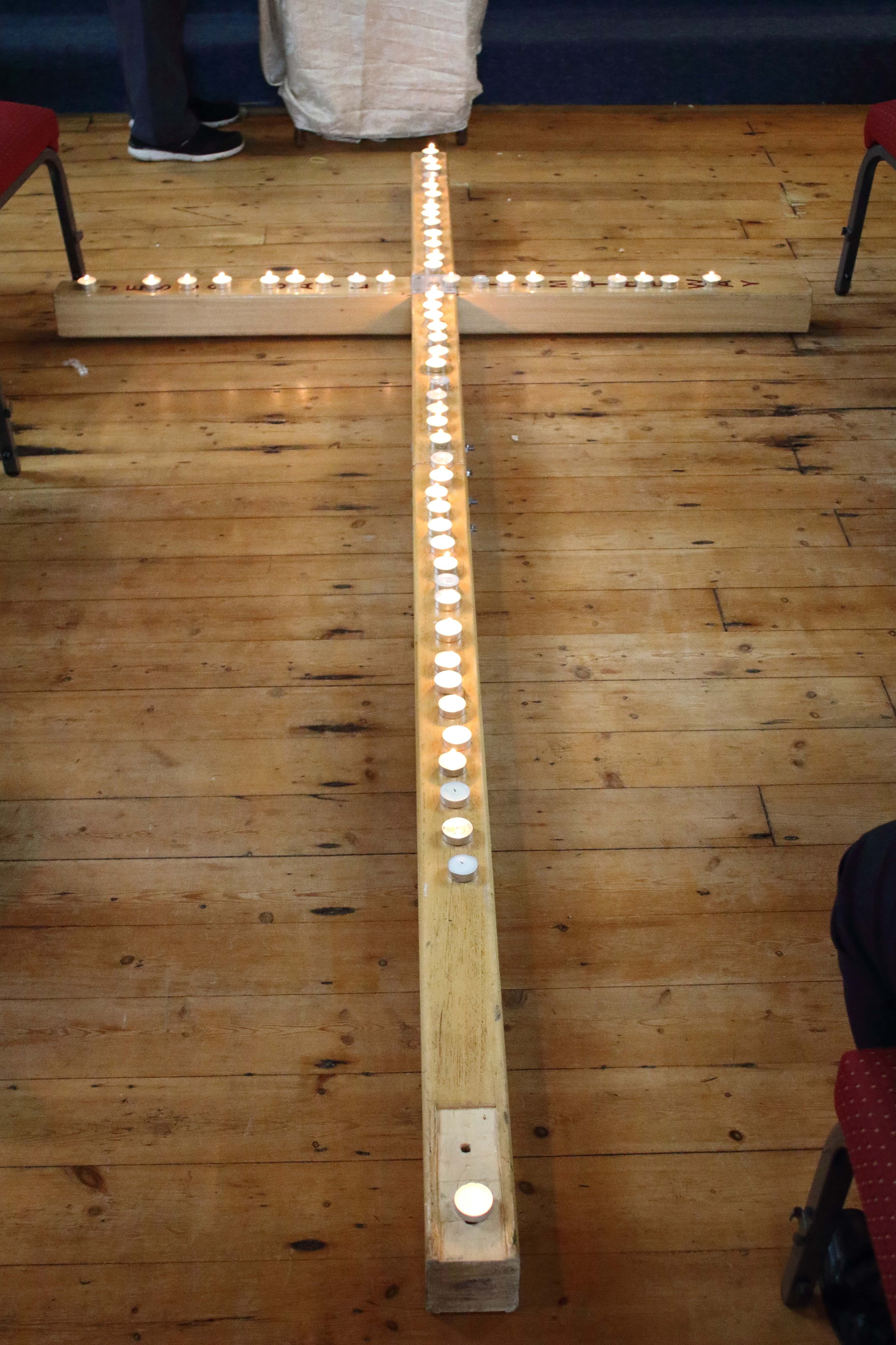 Candles Laid on our Cross