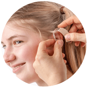 Child being fitted for hearing aid to combat hearing loss