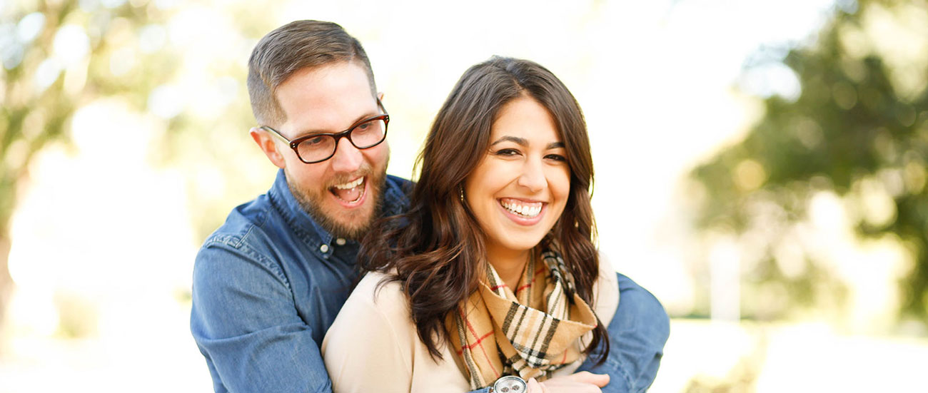 Photo of a smiling couple.
